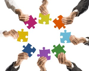 http://www.dreamstime.com/stock-images-teamwork-integration-concept-businessman-holding-colorful-puzzle-image34903714